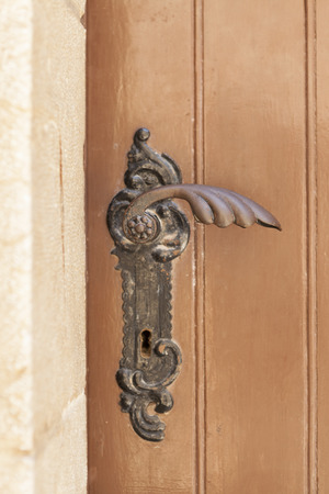 ornated: Ancient metal ornated church door handle