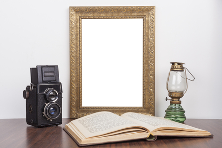 old frame: Old Gold portrait frame with old camera and open book with lamp