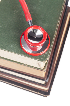 red stethoscope: Old Books Red Stethoscope Isolated on White Background