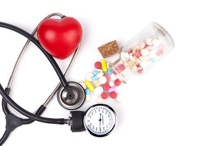pharmacologist: Black Stethoscope with jar of pills and red heart Close-up Isolated On White Background