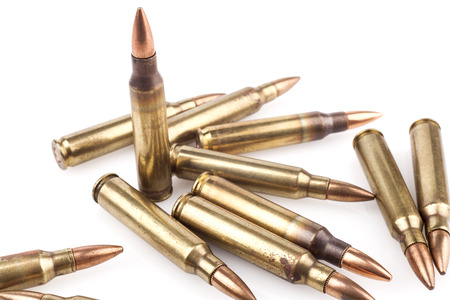Isolated Bullets On White Background With Reflection Stock Photo