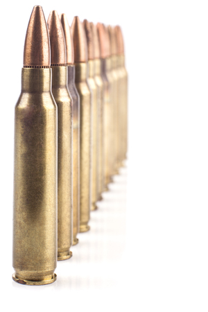 Row of  Isolated Bullets On White Background With Reflection