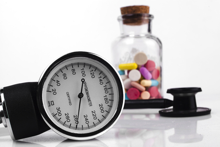 conduction: Colored Pills in a Jar with Sphygmomanometer and Black Stethoscope