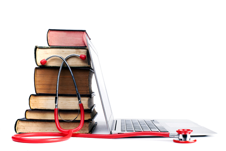 red stethoscope: Red Stethoscope and Old Books  With Silver Laptop Isolated on White Bakcground