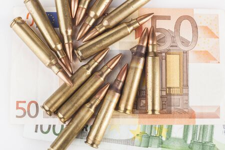 Euro Bancknotes with Rifle  Bullets Stock Photo