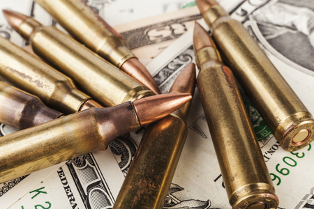 American Dollar Bancknotes with Rifle Bullets
