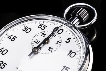 reflexion: Cronómetro aislado en el fondo negro con un poco de reflexión