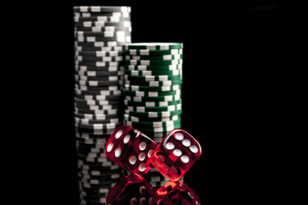 reflexion: Dice and chips isolated on black background with reflexion