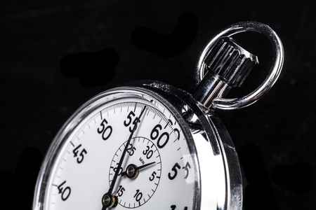 chronometer: Part of a chronometer isolated on black background Stock Photo