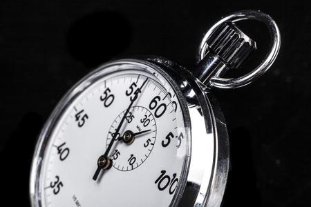 chronometer: Silver chronometer object isolated on black background