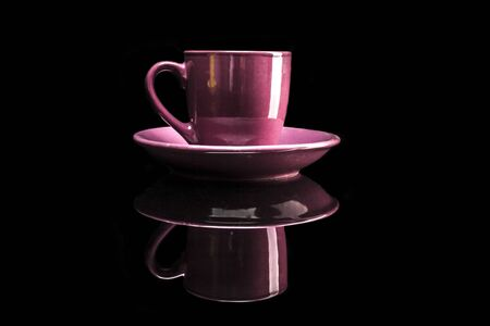 reflexion: Pink cup isolated on black background with reflexion