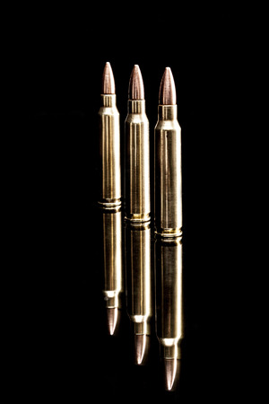 m16 ammo: Bullets isoloated on black background with reflexion