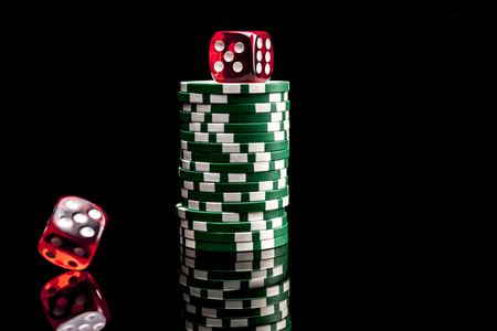 reflexion: Dices and chips isolated on black background with reflexion