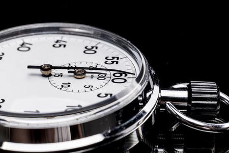 chronometer: Chronometer isolated on black background with reflexion