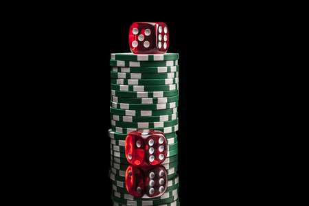reflexion: Dice and chip isolated on black background with reflexion