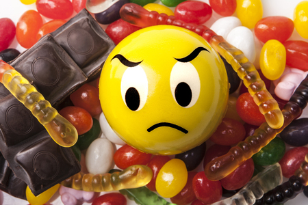 jellybean: Angry emoticon and a lot of sweets