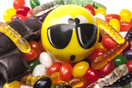 jellybean: Emoticon with sunglasses and a lot of sweets