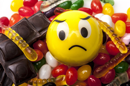 jellybean: Sad emoticon and a lot of sweets