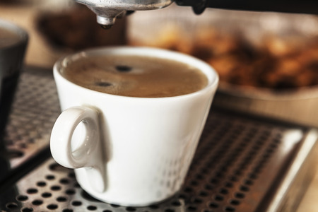 espreso: White cup filled with some delicious coffee Stock Photo