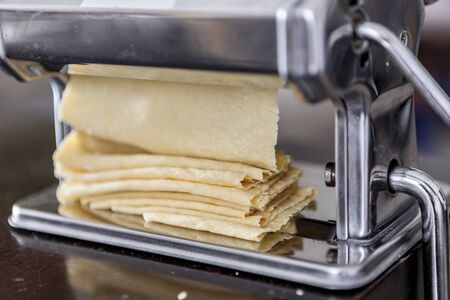 tr: Making homemade pasta with flour and eggs Stock Photo