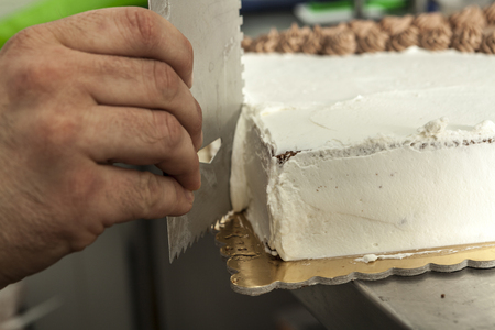 decorate: Hand making a delicious sweet cake foe me Stock Photo