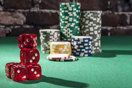 red dice: Red dice and chips on green table with shadow Stock Photo