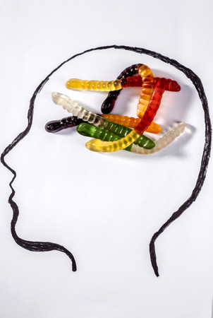 jelly head: Colorful jelly snake brain on a drawn head Stock Photo
