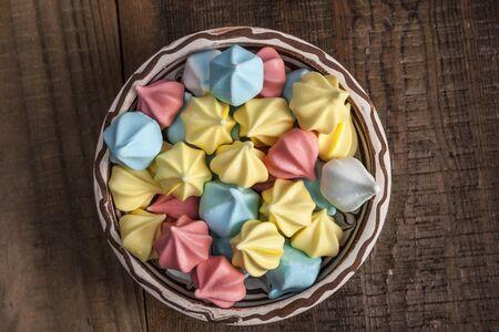 rainbow circle: Rainbow circle sweets on brown wood table Stock Photo
