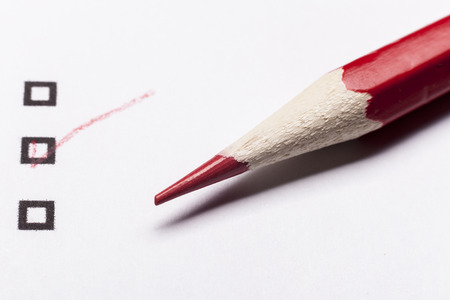 Red pencil on white paper with checkbox Stock Photo