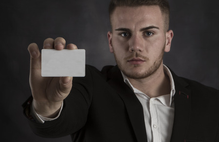 businesscard: Young Man in Suit Holding Blank White Businesscard