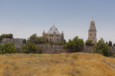 Old Jerusalem church with yellow dry grass Stock Photo