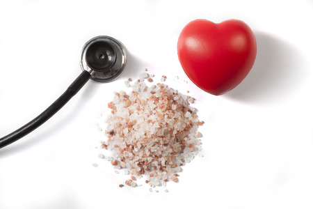 Himalayan Salt Raw Crystals With Red Heart and Black Stethoscope Isolated on White Background