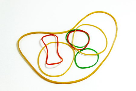 Close-up top shot of colorful rubber band with blurry white background