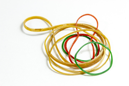 Close-up shot of colorful rubber band with blurry white background