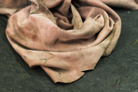 old pink pale washcloth in the repair shop
