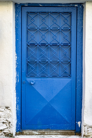 Front shoot of blue colored metal door with traditional turkish pattern