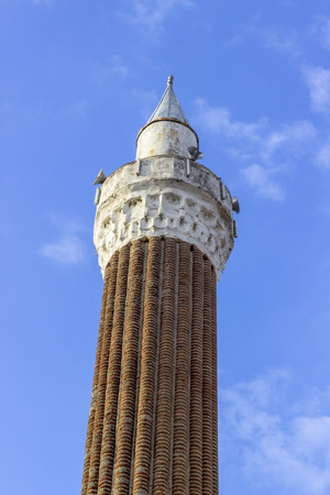 Vertical shoot of 500 years old masony mosque minaret in local places of Turkey Imagens