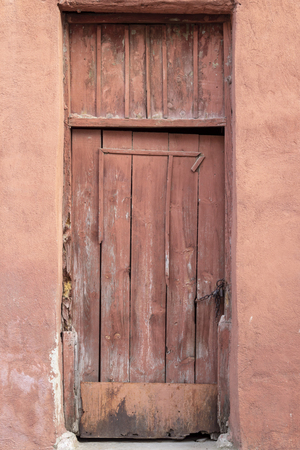Front shoot of traditional wooden door in turkish village Imagens