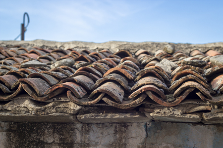 Close-up shoot of corner of masonry roof structure tiles at old ruined building