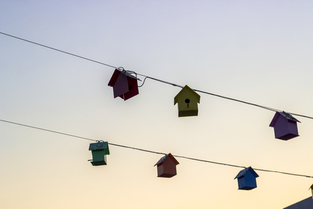 Perspective shoot of sweet bird houses at sunset time Imagens