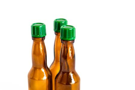 Close-up shoot of three small alcohol bottles brown colored