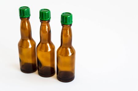 Perspective up shoot of three small alcohol bottles brown colored