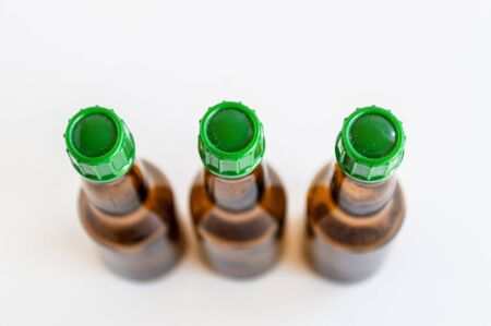 Top shoot of three small alcohol bottles brown colored