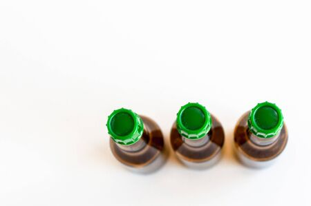 Top corner shoot of three line positioned small alcohol bottles brown colored