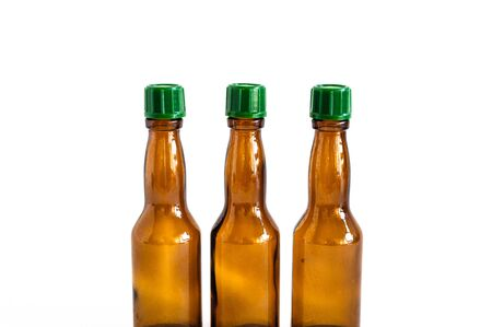Clear front shoot of brown liquour bottles with white background Stok Fotoğraf