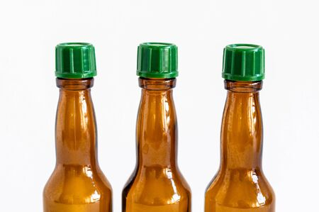 Close-up front shoot of brown liquour bottles with white background