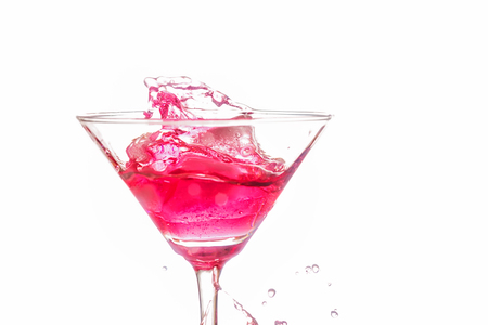 bartend: Red coctail splash on white background close up Stock Photo