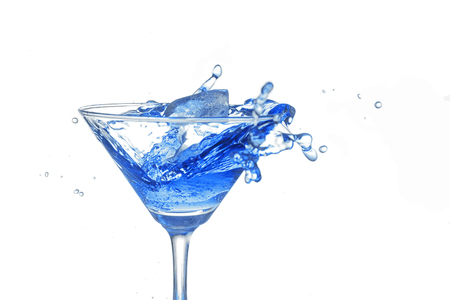 bartend: blue cocktail splash on white background close up Stock Photo