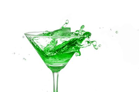 bartend: Green cocktail splash on white background close up