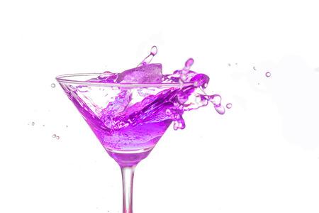 bartend: Purple cocktail splash on white background close up